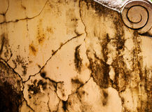 Worn, rust and weathered paint on textured cement. Royalty Free Stock Image