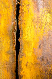 Worn rusty metal sheet with vertical trench Royalty Free Stock Photos