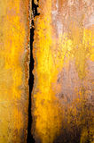 Worn rusty metal sheet with vertical trench Royalty Free Stock Images