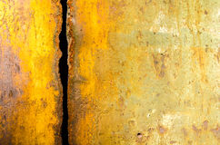 Worn rusty metal sheet with vertical trench Stock Images