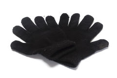 worn gloves. Worn and shabby looking black gloves  on white Stock Image