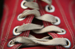 Worn shoe and laces. Old red shoe and worn laces Stock Photos