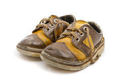 Worn Shoes. A picture of a pair of old vintage leather child shoes Stock Photography