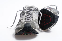 Worn sneaker trainers. Set against white background Royalty Free Stock Images