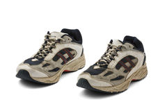 Worn Sneakers Trainers. Pair of old running shoes isolated on white with clipping path Stock Photography