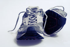 Worn Sneakers Trainers. Slightly Worn Sneakers Trainers with laces Stock Image