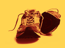 Worn Sneakers Trainers color toned. Macro photo of worn sneakers trainers color toned Royalty Free Stock Image