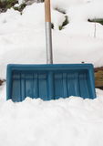 Worn snow shovel repaired with tape around handle Stock Photo