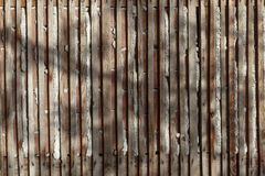 Worn and spaced wooden slats. In the outside stock images