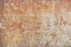 Worn stucco wall in ochre and earth colours Stock Photos