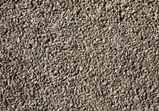 Worn tarmac road surface. Royalty Free Stock Photo