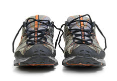 Worn Training Sneakers. A pair of worn trainers or sneakers on white royalty free stock image