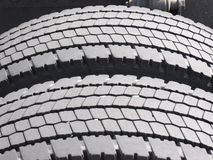 Worn truck tires. Heavy load truck tires with small stones in tread Stock Image
