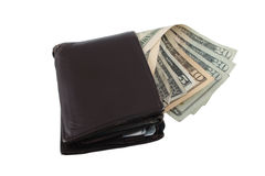 A worn wallet with a spread of bills. A worn out wallet with a several US bills fanned out Royalty Free Stock Photography