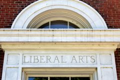 Worn and Weathered Liberal Arts Sign. Worn and weathered liberal arts lettering on brick wall royalty free stock image