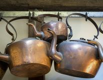 Old Colonial Era Copper Kettles. Worn and weathered old copper kettles from early Colonial America Stock Photos
