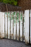 Worn Weathered Picket Fence. With White and Green Paint Royalty Free Stock Photography
