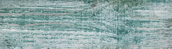 Worn white weathered paint with green underneath. Worn white weathered painted board with green underneath Royalty Free Stock Photography