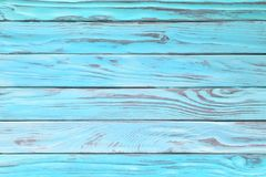 Worn wood of turquoise or blue color. Painted wooden texture as. Old wood texture painted in teal or turquoise color. Light blue wooden table, top view stock image