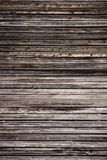 Worn wooden facade. The close-up of the surface of a worn wooden facade stock photo