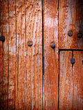 Worn wooden fence and nail heads. Section of worn wooden fence with nails and patchwork, showing slight lens vignetting Stock Photo
