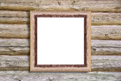 Worn wooden frame. With clipping path hanging on a log wall Stock Photography