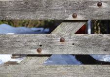 Worn wooden gate with rusty bolts Royalty Free Stock Photography