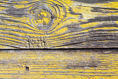 Worn yellow wooden panel. Worn and weathered yellow wooden boat panel stock images