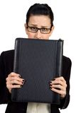 Worried. Female holding briefcase looking worried Stock Photo