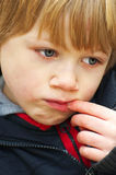 Worried. A young boy with a worried expression royalty free stock images
