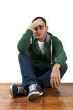 Worried. Young depressed male sitting holding his head with hand Stock Images