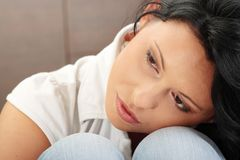 A worried and afraid young woman stock images