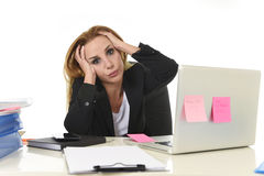 Worried attractive businesswoman in stress working with laptop c Stock Photography