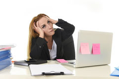 Worried attractive businesswoman in stress working with laptop c Royalty Free Stock Photos