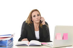 Worried attractive businesswoman in stress working with laptop c Stock Images