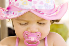 Worried baby girl with dummy Royalty Free Stock Images