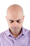 Worried bald man looking down. Royalty Free Stock Images