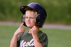 Worried Base Runner. Young boy in glasses is a worried little league baseball runner Stock Photos