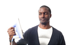 Worried black man with an iron. Isolated on white Stock Images
