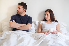 Worried and bored lovers couple after arguing Stock Images