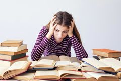 Worried and bored student. With books royalty free stock image
