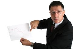 Worried boss showing bad results to his workers Stock Photo