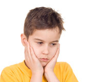 Worried boy. Holding his head in hands Stock Photo