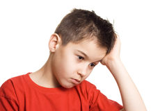 Worried  boy. Boy in pain having a headache- isolated Royalty Free Stock Photo