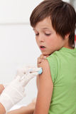 Worried boy getting an injection Stock Images