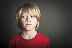 Worried boy Stock Images
