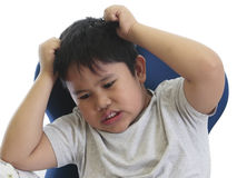 Worried boy scratching his head Stock Photo