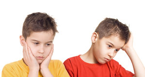 Worried boys. Holding their heads in hands stock photos