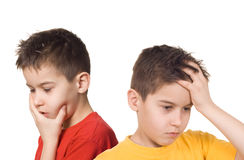 Worried boys. Holding their heads in hands royalty free stock photography