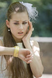 Worried bride looking at watch Royalty Free Stock Photo